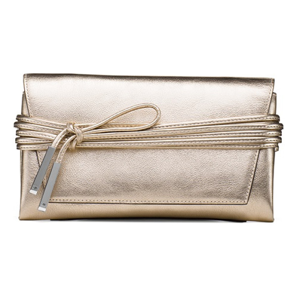 STUART WEITZMAN Miniblacktie - This must-have mini clutch fuses fashion and function. The...