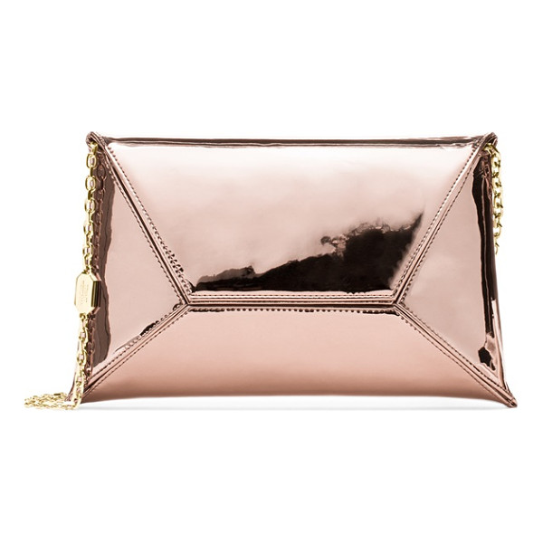STUART WEITZMAN Petite - No closet is complete without a classic envelope clutch,...