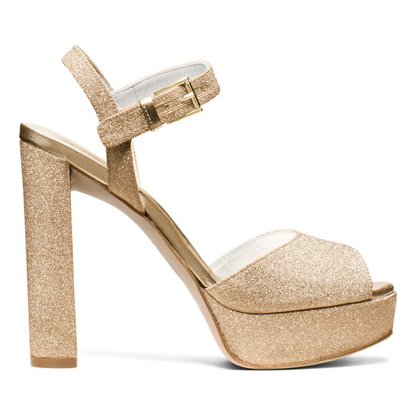 STUART WEITZMAN Sashay - This sexy, Seventies-inspired sandal is set on a stacked...