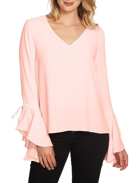 1.State cascade sleeve blouse in pink opal - Ties gather the ruffled cuffs of an easy-fitting top...