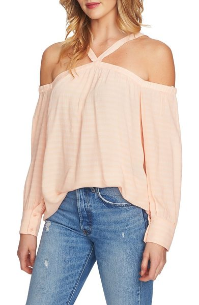 1.State cold shoulder blouse in golden apricot - Flash a little skin in this top that transforms from...