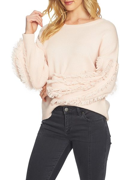 1.State fringe sleeve sweater in 602-rose buff - Rows of fringe further the statement-making impact of...