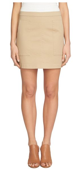 1.State patch pocket skirt in field khaki - Patch pockets make a modern, minimalist statement on a...