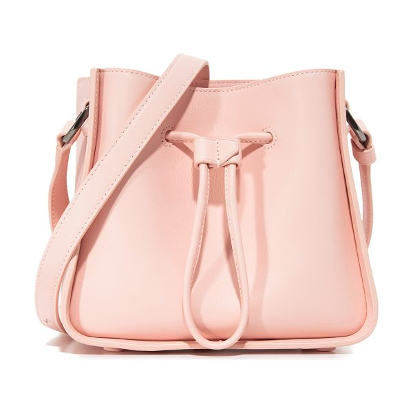 3.1 Phillip Lim soleil mini bucket drawstring in light pink - A boxy 3.1 Phillip Lim bag in smooth leather. Drawstring...
