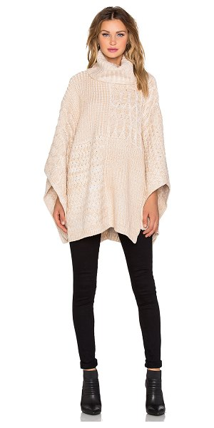 525 America Patchwork turtleneck poncho in tan - 100% acrylic. Hand wash cold. 525A-WK76. W5723. 528...