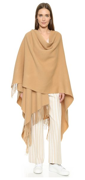 Acne Studios Apolo fringe poncho in caramel brown - A cozy Acne Studios poncho designed for versatility. The...