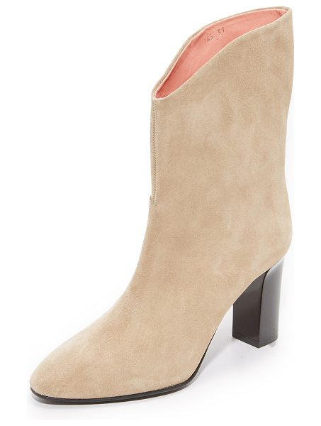 Acne Studios ava boots in natural - Suede Acne Studios boots styled with a slouchy shaft and...
