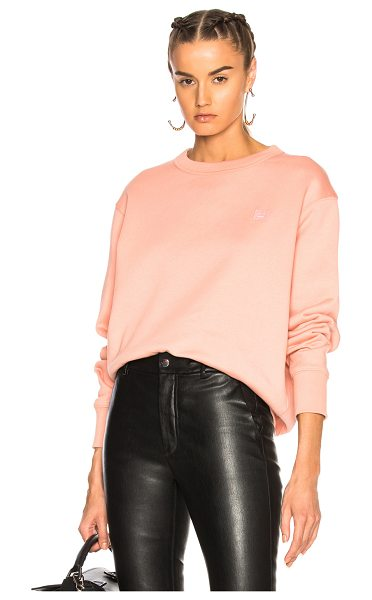 Acne Studios Fairview Face Sweater in pink - 100% cotton.  Made in Portugal.  Machine wash. ...