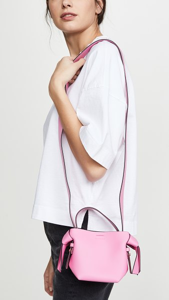 Acne Studios musubi micro bag in pink/black