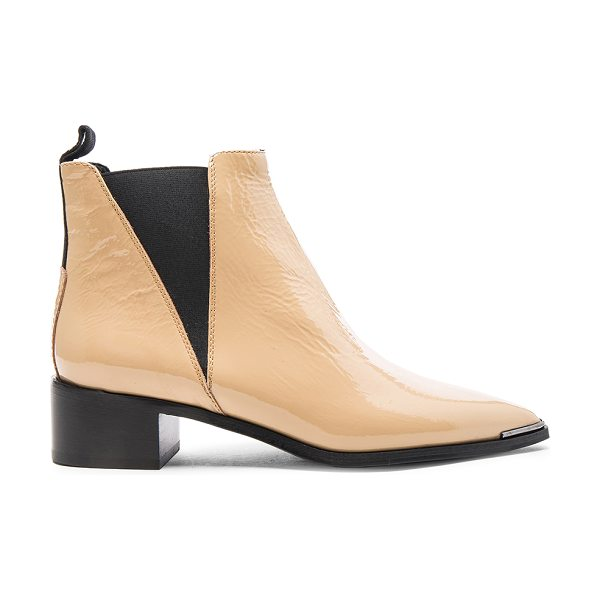 Acne Studios Patent Leather Jensen Booties in neutrals - Patent leather upper with leather sole.  Made in Italy. ...