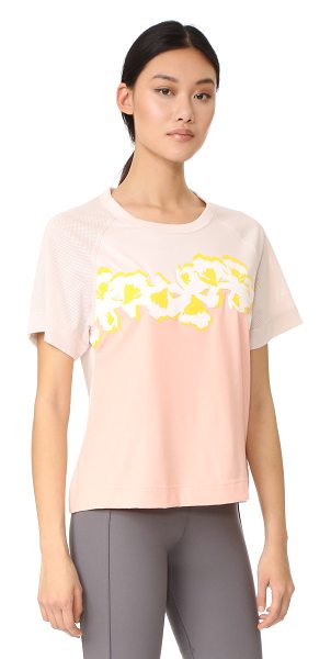Adidas By Stella McCartney yoga flower tee in echo pink/dust pink - Bonded floral appliqués accentuate the soft color of...
