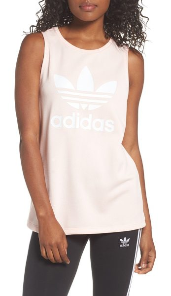 Adidas loose fit trefoil logo tank in icey pink - adidas' signature trefoil logo fronts a comfy sleeveless...