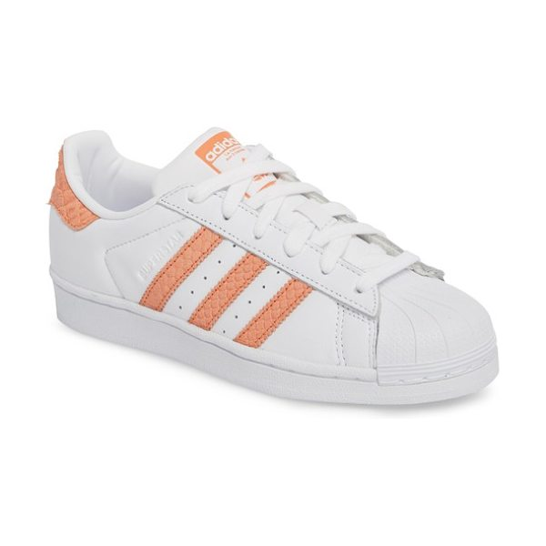 Adidas superstar sneaker in white/ chalk coral/ off white - First introduced in 1969, this iconic basketball shoe...