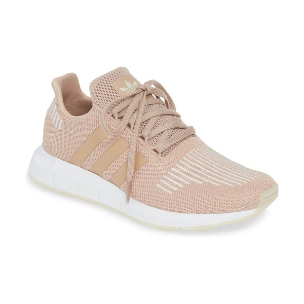Adidas swift run sneaker in beige - A sleek new silhouette inspired by running shoes in the...
