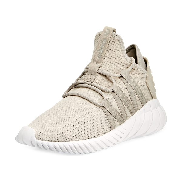Adidas Tubular Dawn Knit Trainer in light brown - Adidas knit trainer with rubber trim. Flat heel with...