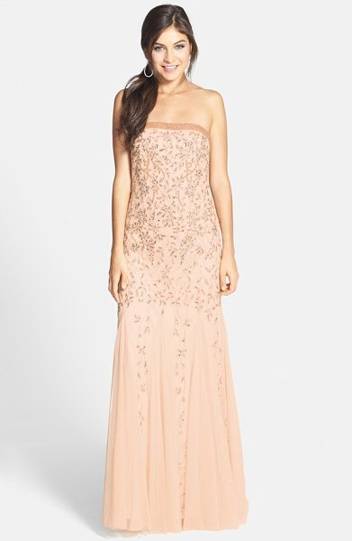 Adrianna Papell beaded mesh gown in champagne - Tonal beads highlighted by glittering sequins sprout...
