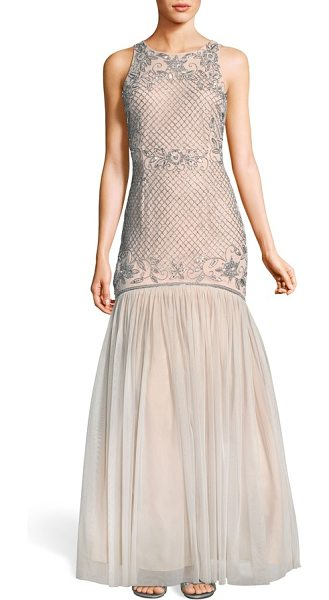 Adrianna Papell beaded tulle trumpet gown in silver/ nude - A net of twinkling beads drapes over the curve-hugging...