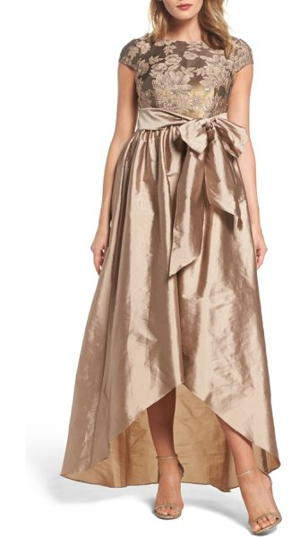 Adrianna Papell embellished taffetta high/low gown in antique gold - A large tie sash separates the sequined, embroidered...
