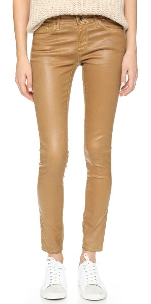 AG Adriano Goldschmied The leatherette legging ankle jeans in caramel - AG skinny jeans with a slick, leather like coating. 5...