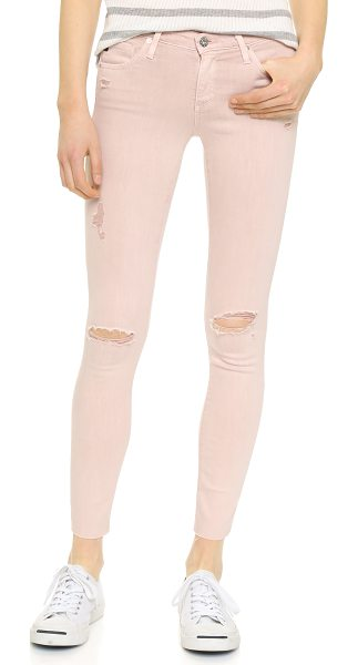 AG Adriano Goldschmied the legging ankle jeans in sun faded distressed sandy ros - Soft super stretch denim lends a curve hugging fit to...