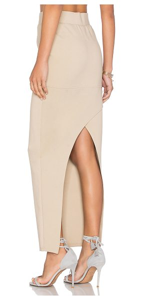 AGAIN Angie Skirt in beige - Poly blend. Dry clean only. Unlined. Elastic waist....