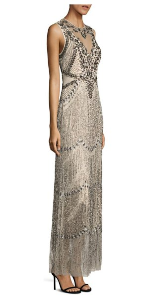 AIDAN MATTOX sleeveless beaded fringe gown in champagne - Striking embellishments accentuate this fringe gown....