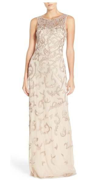 Aidan Mattox sleeveless beaded gown in champagne - Beaded floral appliques fashion the sheer yoke and twine...