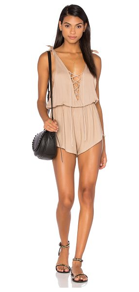Aila Blue Foxy Romper in tan - 100% rayon. Hand wash cold. Elasticized waist. Lace-up...