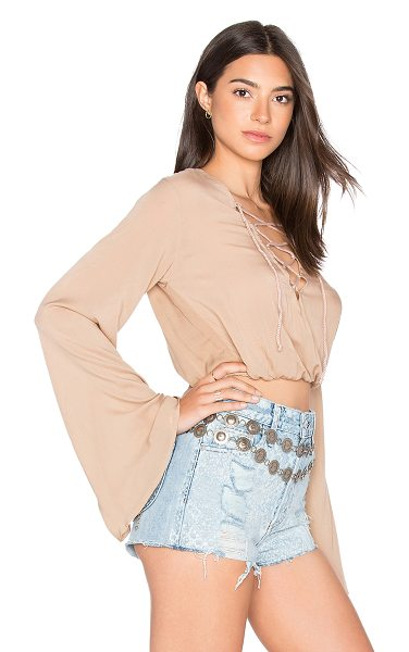 AILA BLUE Palm Crop Top in brown - 100% rayon. Hand wash cold. Lace-up front detail....