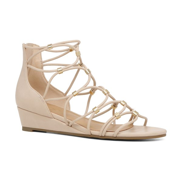 ALDO Adiema in bone - Spotlight the perfect pedi in this strappy embellished...