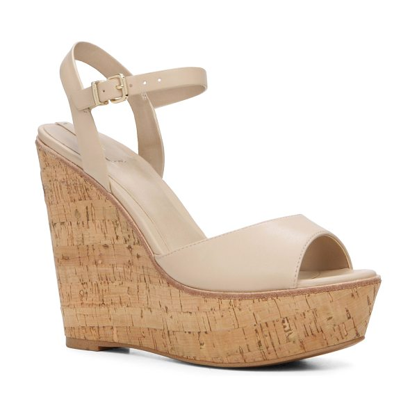 ALDO Aralinna in bone - Pop the cork in this '70s- inspired wedge. From flared...