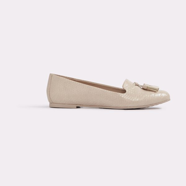 ALDO Auchi in bone - This tassel topped slip-on flat offers a touch of boho...