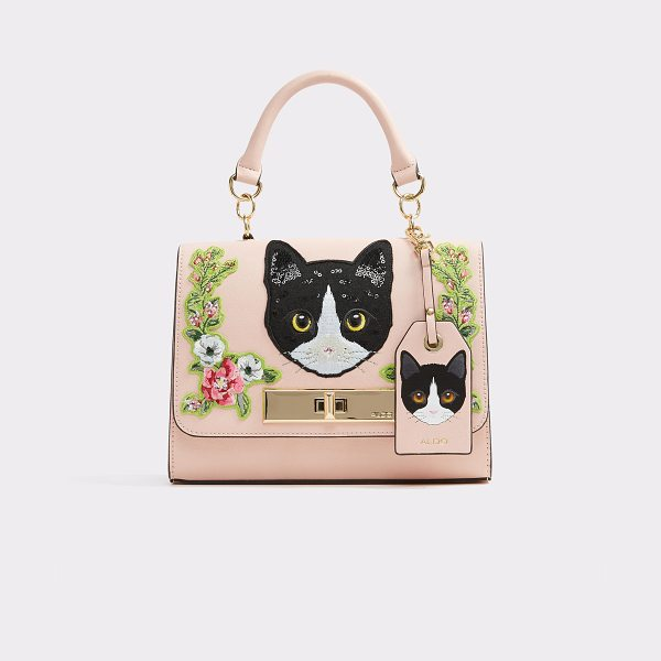 ALDO Corvara in light pink - This playful purse, featuring feline faces, is the...