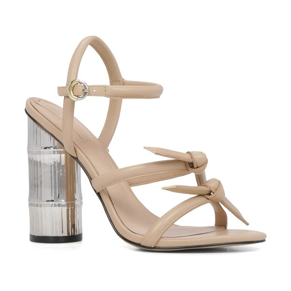 ALDO Elylia in bone - Knotted straps stand on a metallic block heel for a fun,...