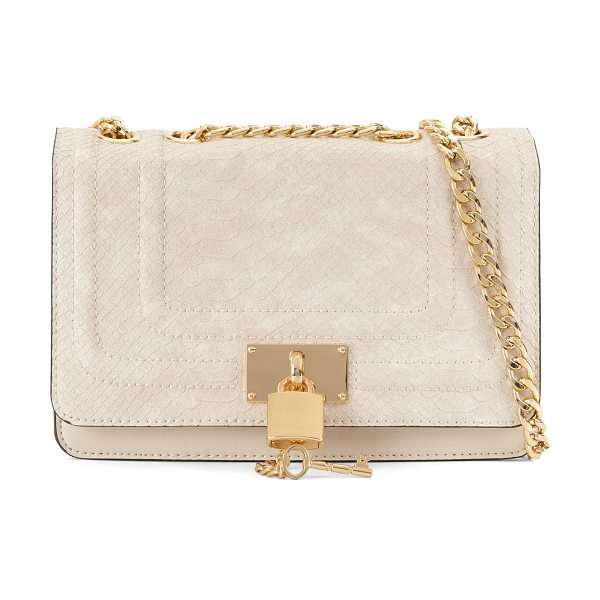 ALDO Gloang sandals in natural - Secrets are safe with this small crossbody bag and its...