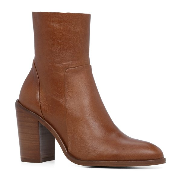 ALDO Greca boots in cognac - Mod half-calf bootie heads west with a cowboy-inspired...