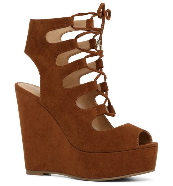 ALDO Jennelle - A striking ghillie-inspired sandal with atowering wedge...