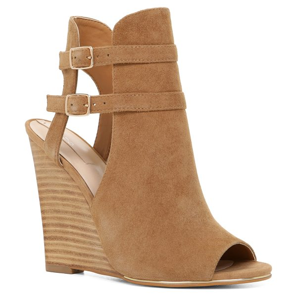 ALDO Legirassi in cognac - Get effortless style, day or night, with this gorgeously...