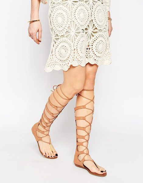 ALDO Marianne nude ghillie knee high gladiator flat sandals in tan - Sandals by ALDO, Faux suede upper, Toe-post, Gold...