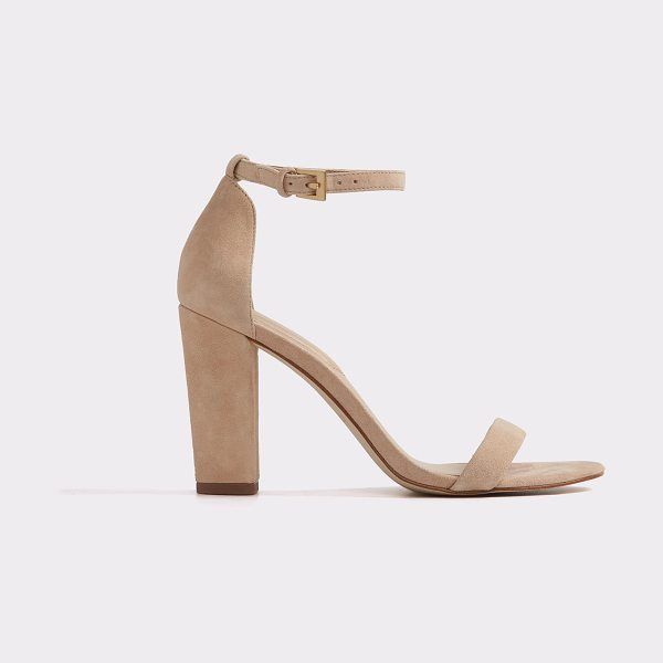 ALDO Myly in bone - Bold, block heel and skinny straps make a play on...