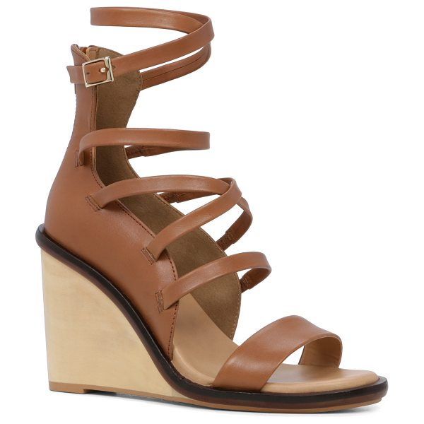 ALDO Russella in cognac - Sexy-made-subtle achieved in a strappy wood wedge...