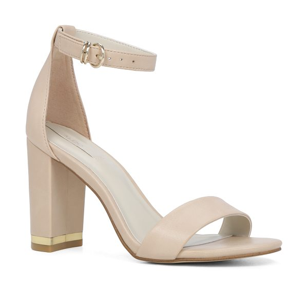 ALDO Schaffert in bone - Minimalist straps and a square heel embellished with a...