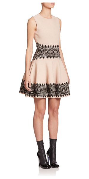 Alexander McQueen Intarsia fit-&-flare dress in beige-black - Intricate intarsia accents embellish the waistline and...