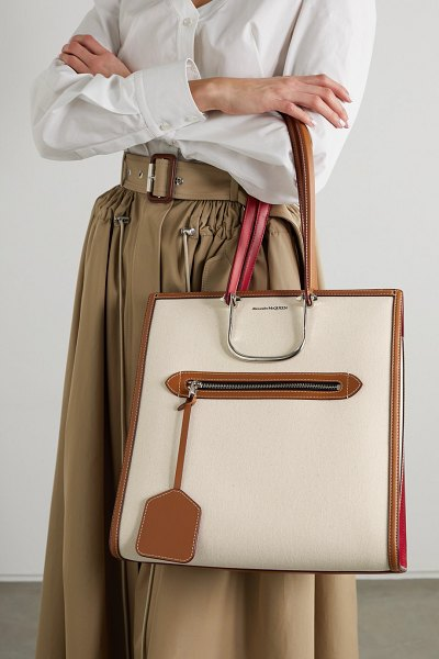 Alexander McQueen the tall story leather-trimmed canvas tote in tan