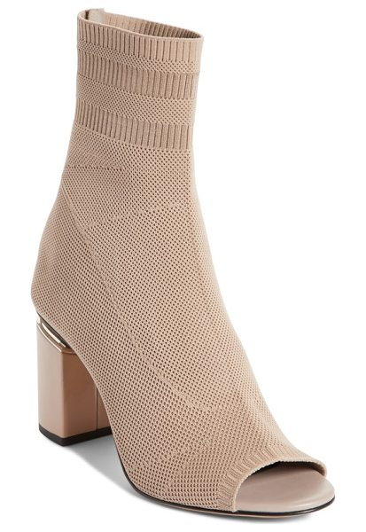 Alexander Wang cat knit sock boot in nude - A floating block heel distinguishes an eye-catching knit...