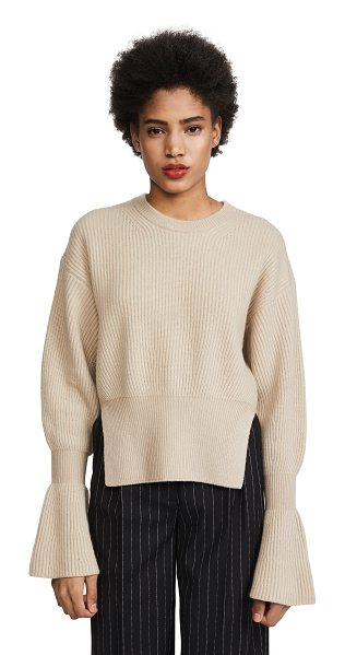 Alexander Wang engineered pullover with side slits in champagne - Fabric: Fuzzy ribbed knit Slits at hem Flared cuffs...