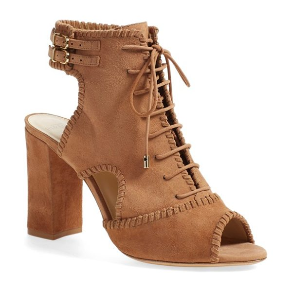 Alexandre Birman abbe peep toe sandal in beige suede - Tonal whipstitching outlines a Western-chic suede sandal...