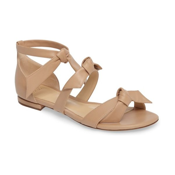 Alexandre Birman lolita sandal in nude - Slim straps with elegant ties top an eye-catching sandal...