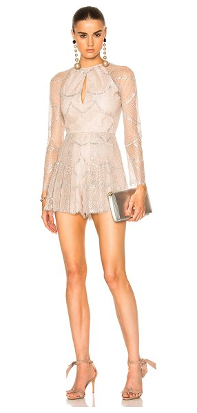 Alexis Chanelle Romper in silver blush - Self: 80% nylon 20% metallicLining: 100% poly. Made in...