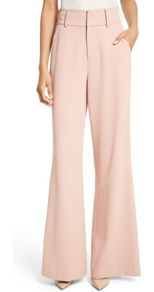 Alice + Olivia dawn flare leg pants in rose tan - A high-waisted cut with voluminous legs brings flowy...
